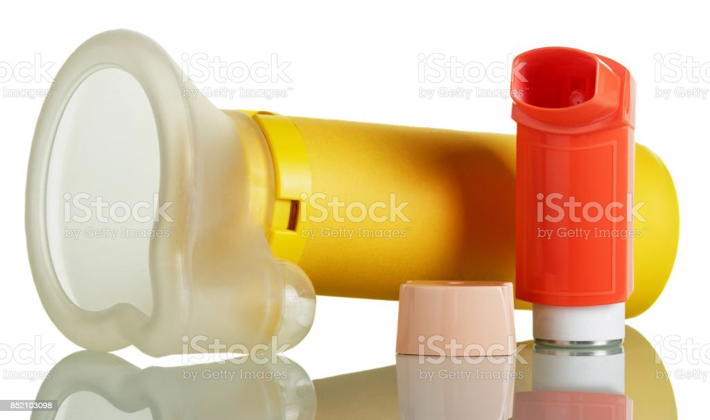 The inhaler and aerochamber isolated on white. stock photo