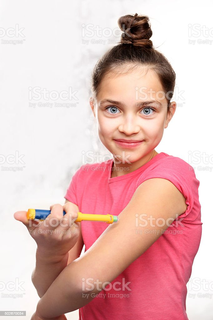 The injection of insulin, a child with diabetes stock photo