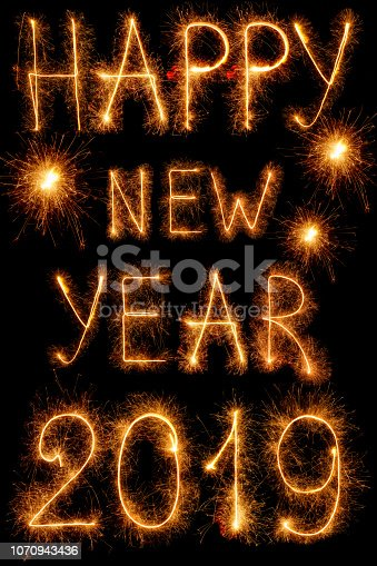 1070880528 istock photo The inscription 2019 new year sparklers isolated on black 1070943436