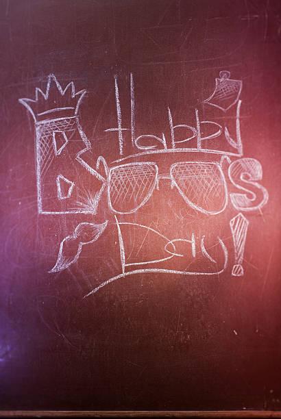 the inscription chalk on the blackboard - happy boss's - boss's day fotografías e imágenes de stock