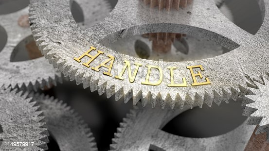 1197953545istockphoto The inscription HANDLE on the gear of the clock mechanism 1149579917