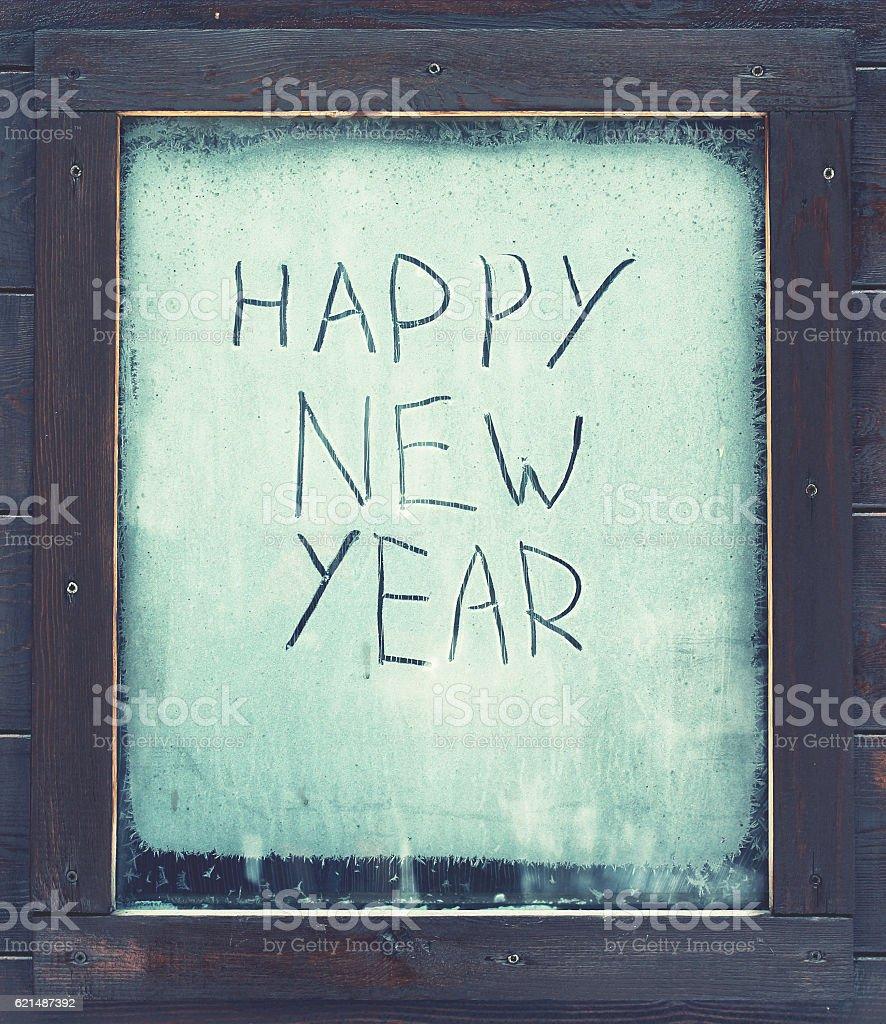 The inscription 'Happy New Year' on the frosty window Lizenzfreies stock-foto