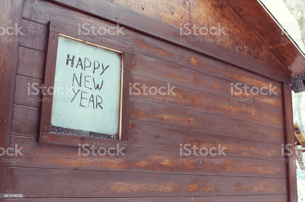 The inscription 'Happy New Year' on the frosty window photo libre de droits