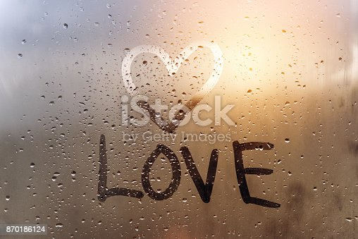 istock The inscription love and hand-drawn heart on the sweaty glass. 870186124