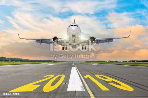 istock The inscription on the runway 2019, plane taking off. The concept of travel in the new year, holidays. 1064109806