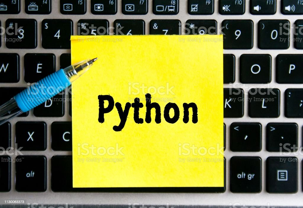 The Inscription Python On A Yellow Sheet Of Sticker Paper On
