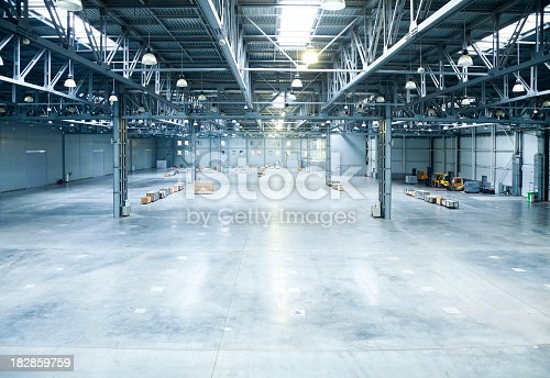 istock The inside of a large and empty modern warehouse 182859759