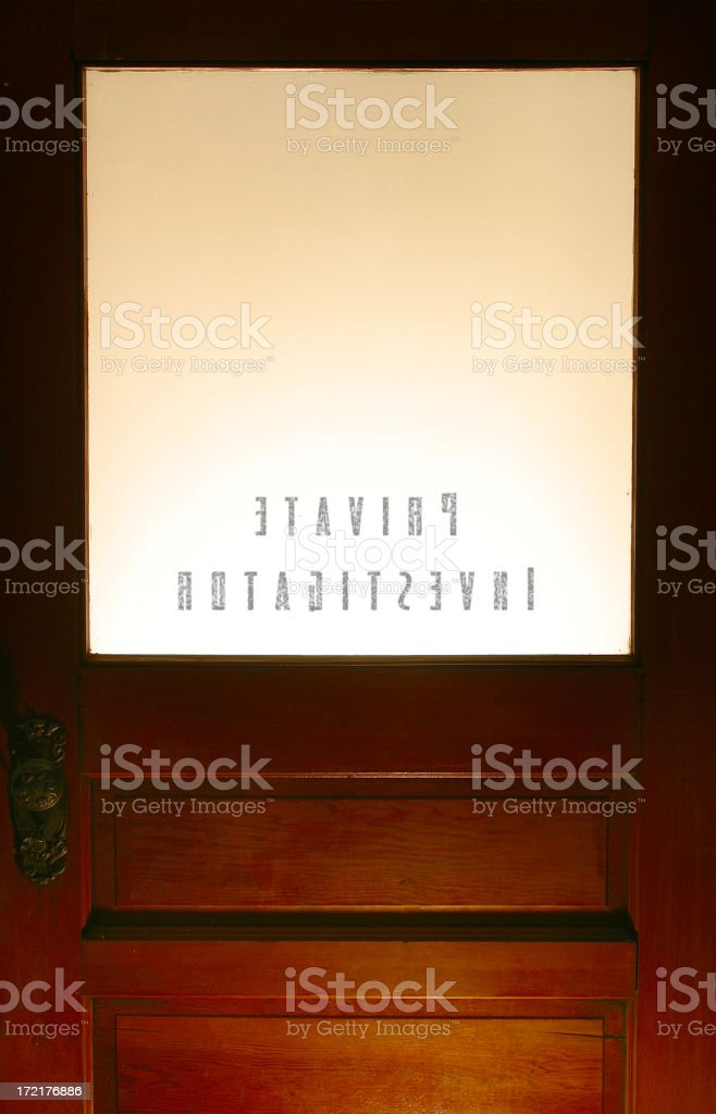 The inside of a private investigator's office door stock photo
