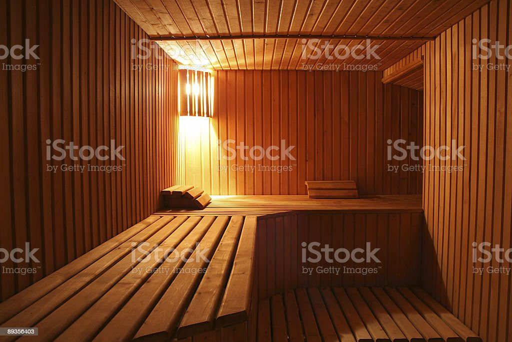 The inside of a wooden sauna room royalty free stockfoto