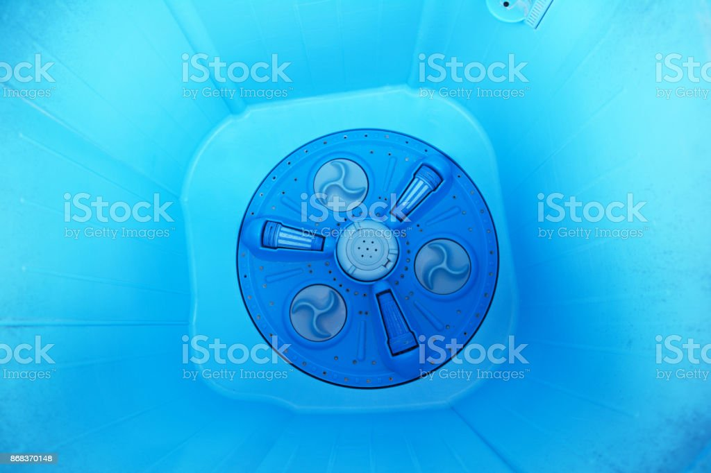 the inside of blue wasing machine plastic tank stock photo
