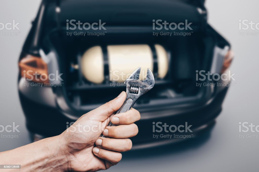The installation of a gas cylinder for NGV in the trunk of a car stock photo