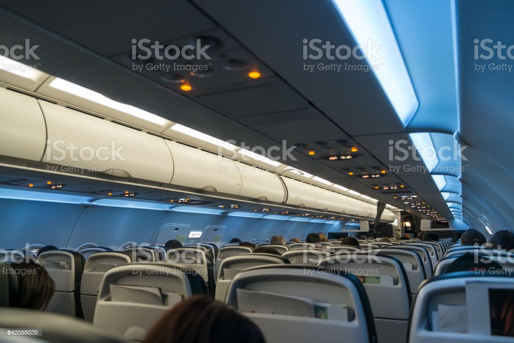 The interior cabin of a modern passsenger airliner jet airplane stock photo