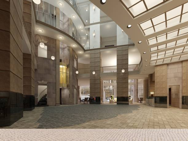 The interior design of the hotel lobby with a large multi-storey interior space. Stone columns, balconies and interfloor elevators.