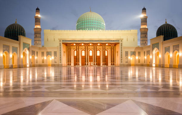 The interior marble floor of the Sultan Qaboos Mosque in Sohar after sunset, Oman stock photo