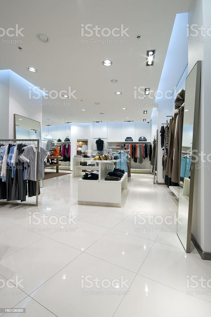 The interior of a clothing store with women's tops royalty-free stock photo