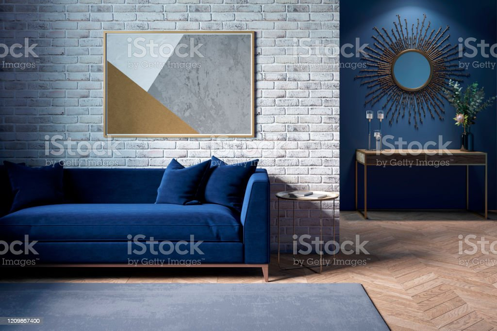The Interior Of A Modern Living Room With A Dark Blue Sofa Next To A Brick Wall On Which A Horizontal Poster Hangs In The Background You Can See A Mirror Above