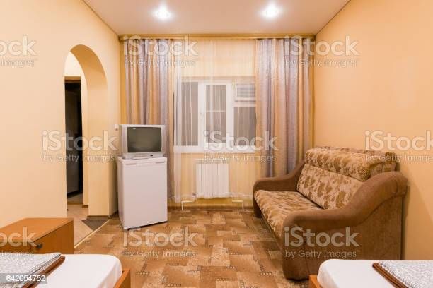 The interior of a small room with sofa bed and two single beds window picture id642054752?b=1&k=6&m=642054752&s=612x612&h=olxu0wn3nikvkg8ktd6exq8mpdtfb41jrvl3p3ttbmq=
