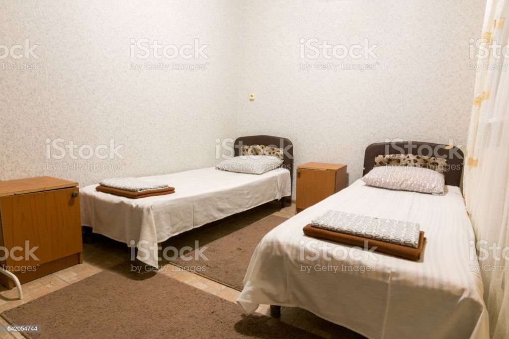 The interior of a small room with two beds stock photo