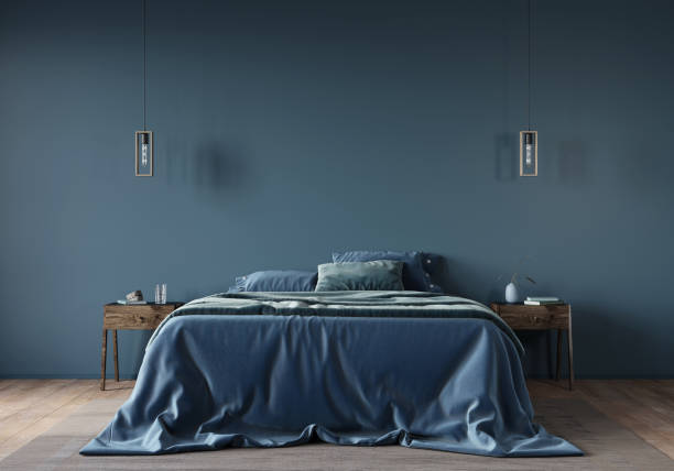 The interior of the bedroom in dark blue with a wide bed