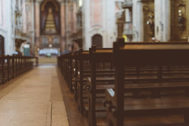 the interior of the church with benches. - church stock photos and pictures