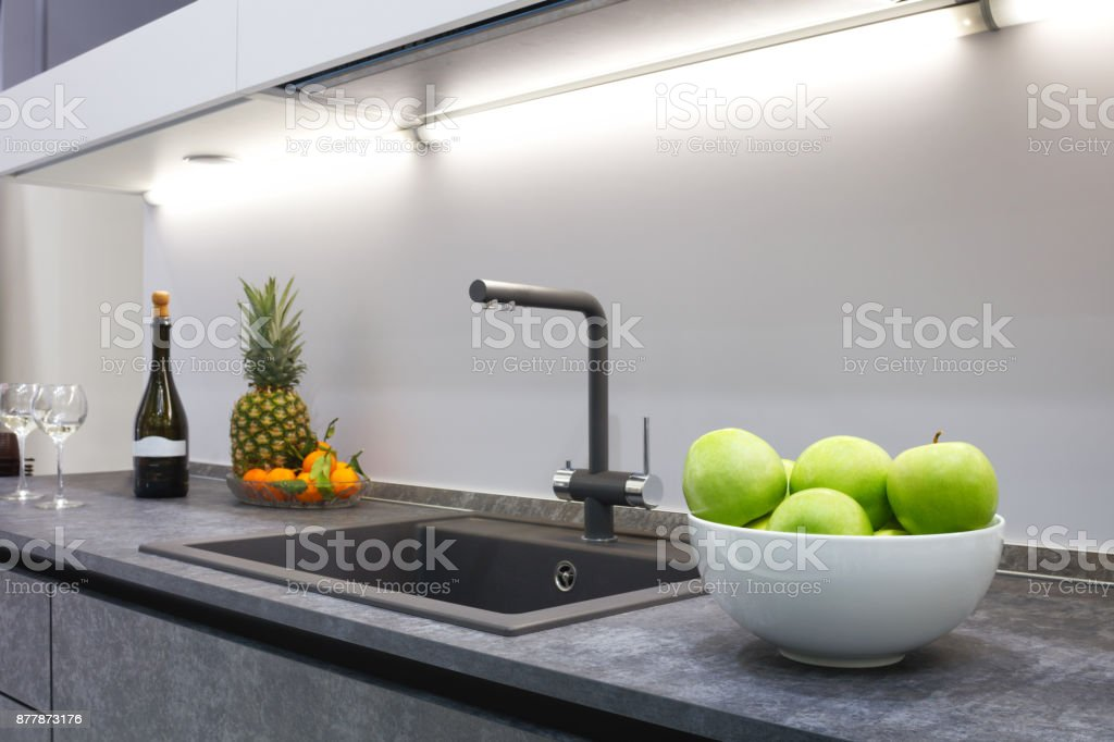 The Interior Of The Modern Kitchen Is Illuminated With A
