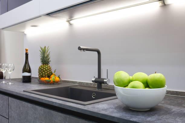 The interior of the modern kitchen is illuminated with a gray stone picture id877873176?b=1&k=6&m=877873176&s=612x612&w=0&h=gjsbpt7dd1k40zqufwhdljqznpog3xcna60hipez 3y=
