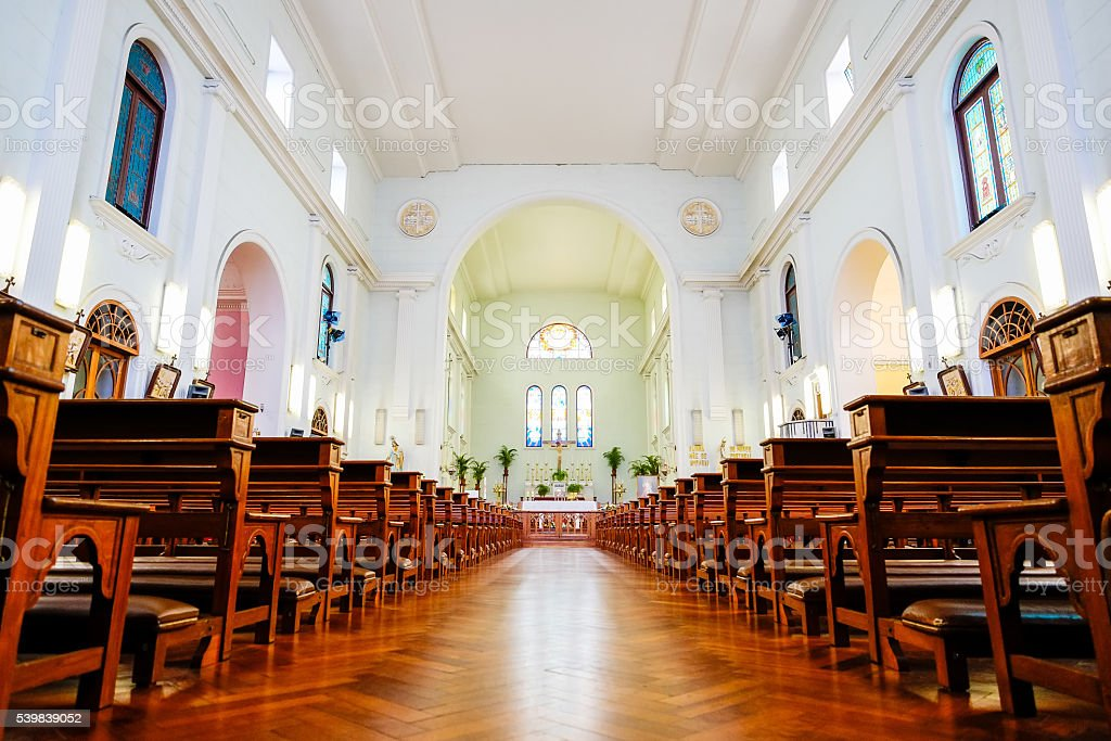 The interior view of church with empty bench in Macao stock photo