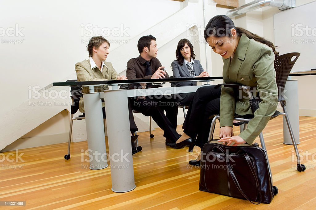 The Interview Woman pulling papers out at meeting. Adult Stock Photo