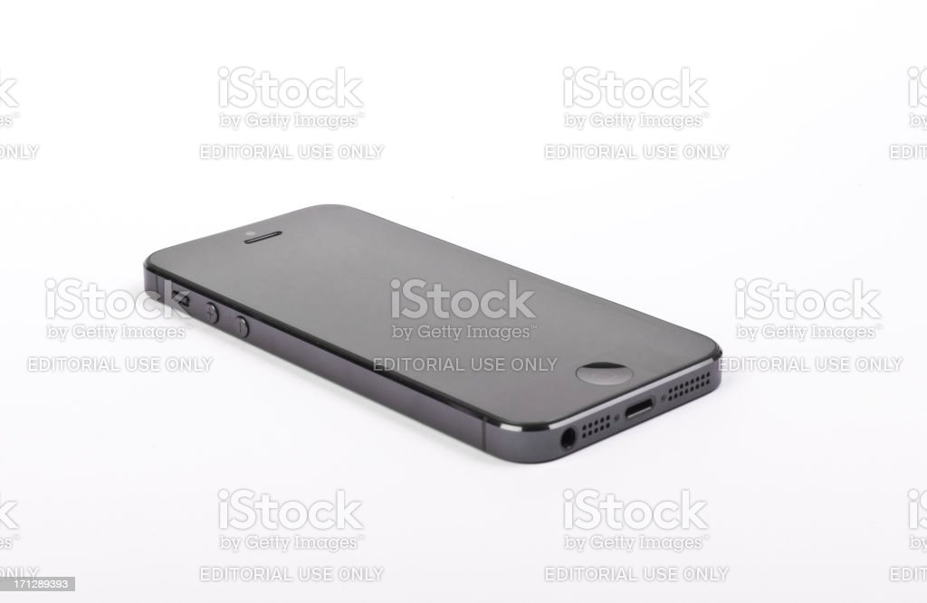 The iPhone 5 by Apple on a white table royalty-free stock photo