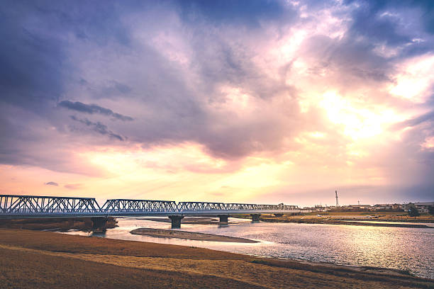 The iron bridge over the river in the nightfall Scenery of the iron bridge over the river in Ishikawa, Japan riverbank stock pictures, royalty-free photos & images