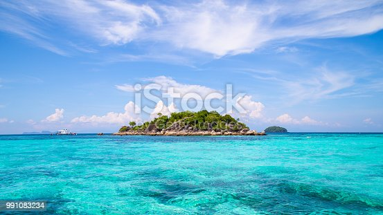 The island is located in the sea The sea is clear and can see the coral. And beautiful sky : Koh Lipe, Satun Province, Thailand