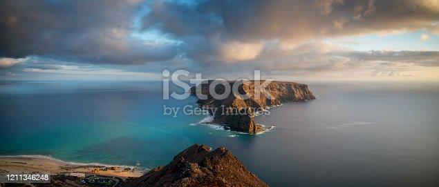 The sun begins to set on the dramatic island of Ilhéu da Cal in Porto Santo, a small Portuguese territory in the western Atlantic.