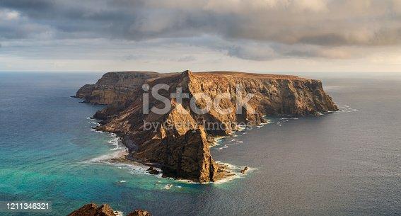 The sun begins to set on the dramatic island of Ilhéu da Cal, just off the coast of  Porto Santo, a small Portuguese territory in the western Atlantic.