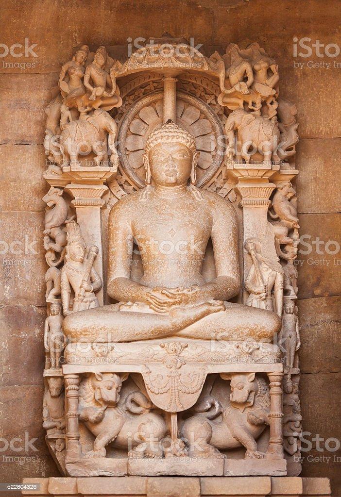 The Jain's statue made of sandstone. Khajuraho, India. stock photo
