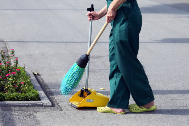 the janitor sweeping broom street stock photo