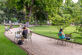 Paris, France - August 5, 2014: casual scenes at the Jardin du Luxembourg park at Paris, with people, boats and the palace