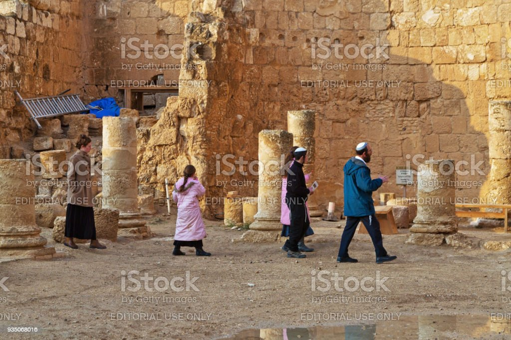 The Jewish family is considering of Herodium (Herodion) Fortress stock photo