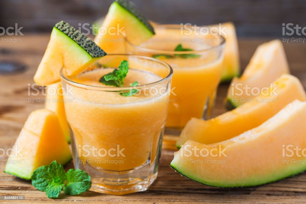 The juice of melon with mint in a glass jar on the table.Hami melon royalty-free stock photo