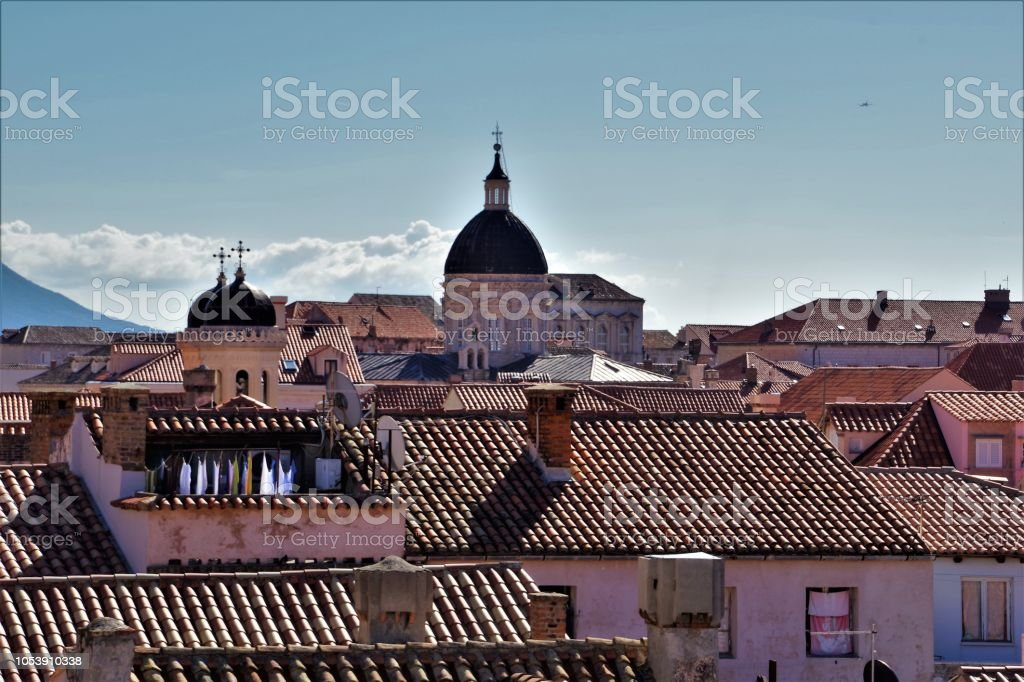 The Jumbled Rooftops of the Old City of Dubrovnik, Croatia as seen from the ancient City Walls and Ramparts that surround it stock photo