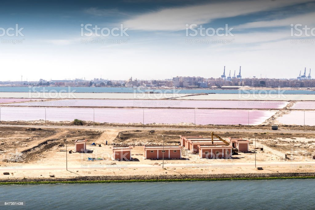 The junction of the Suez Canal into the Mediterranean at Port Said and Port Fouad with their salt marshes stock photo