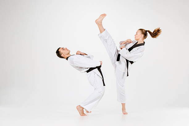The karate girl and boy with black belts stock photo