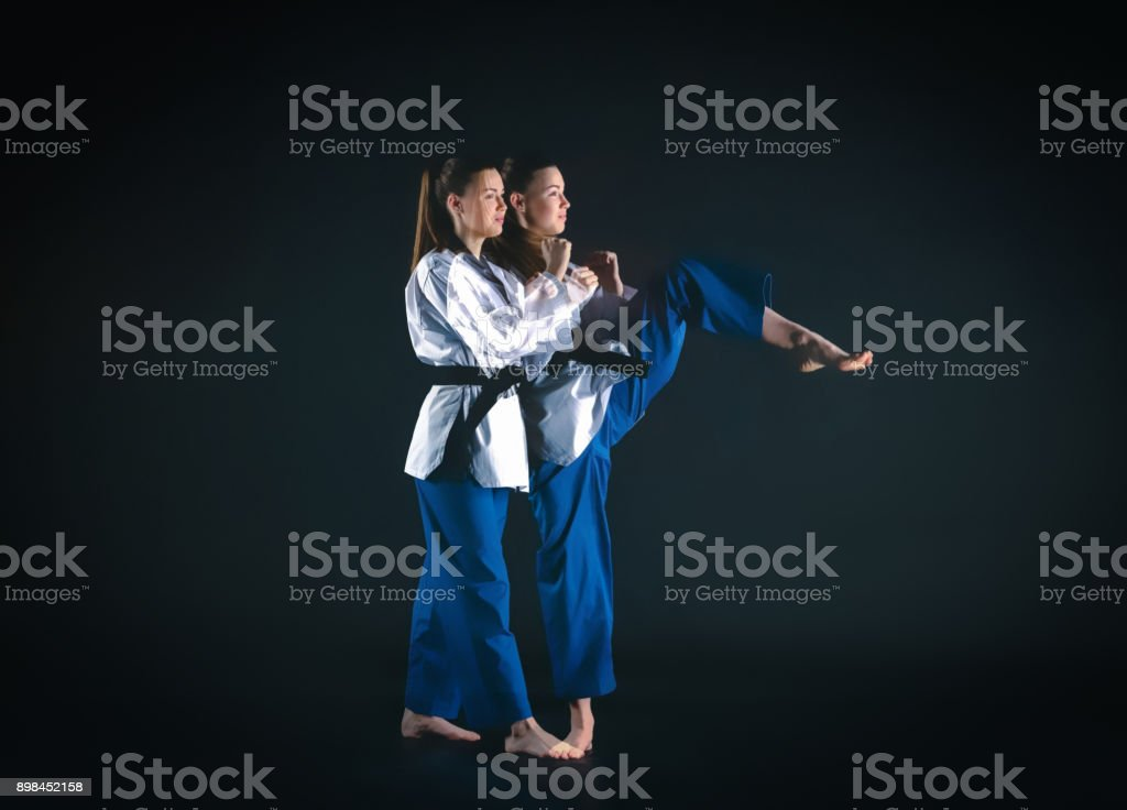 The karate girl with black belt stock photo