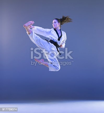 istock The karate girl with black belt 917759074