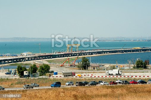 Taman, Russia - July 12, 2017: Construction of a bridge across the Kerch Strait, a view of the coastline and the connection Tuzla Spit from the Taman Peninsula