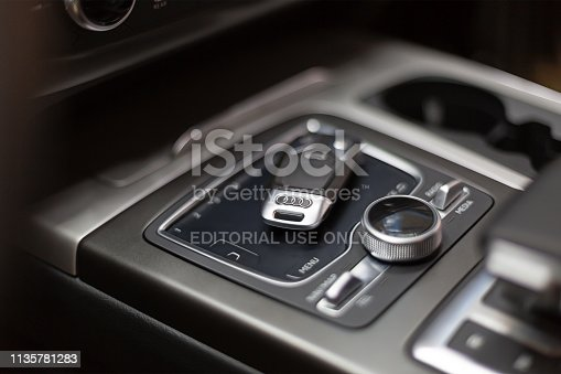 Moscow, Russia - December 05, 2018: The key to Audi lies in the car on the touch panel control. Salon premium car with keyless access.