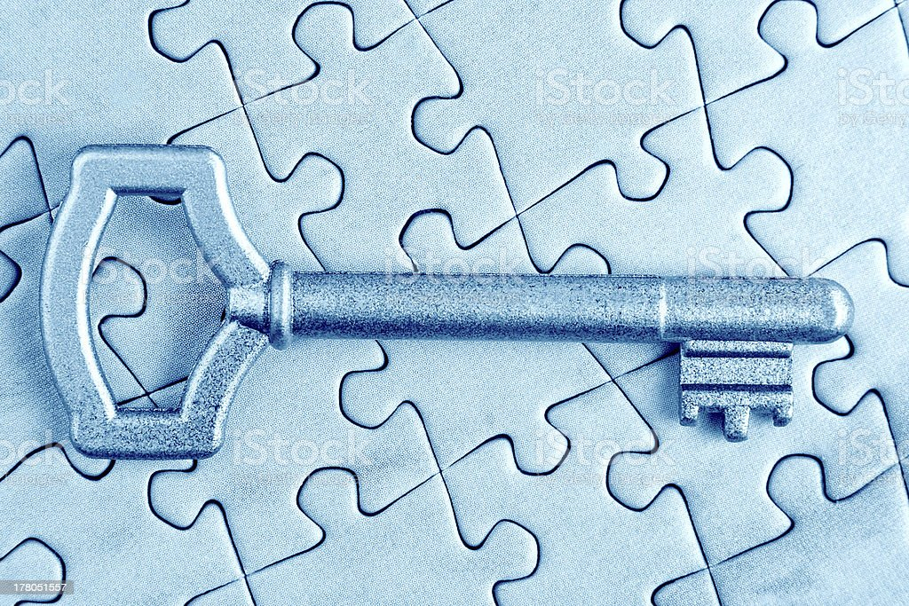 The key to puzzle close in cold tones. royalty-free stock photo