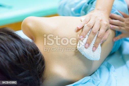 istock The Kid admitted at hospital. Mother rub the body with wet cloth to reduce the fever and temperature. 942845980