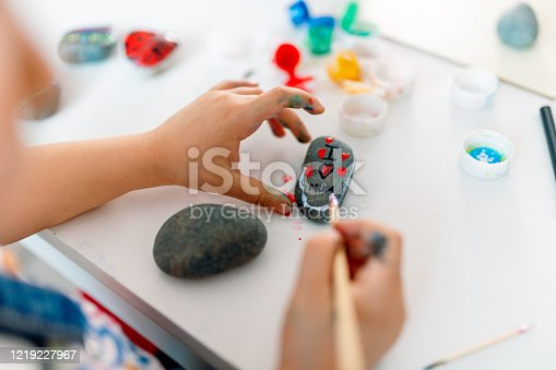 istock The kid who wrote her love for her mother on the stones 1219227967