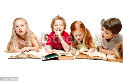 istock The kids boy and girls laying with books isolated on white 1124415529