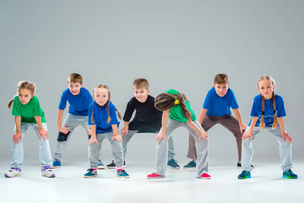 the kids dance school, ballet, hiphop, street, funky and modern dancers - dance group stock photos and pictures